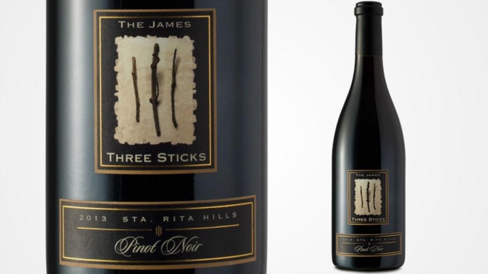 Black wine bottle with gold label