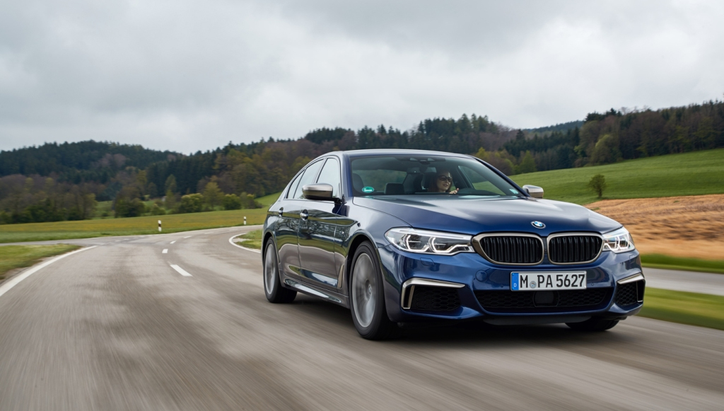 BMW M550i driving through the german countryside