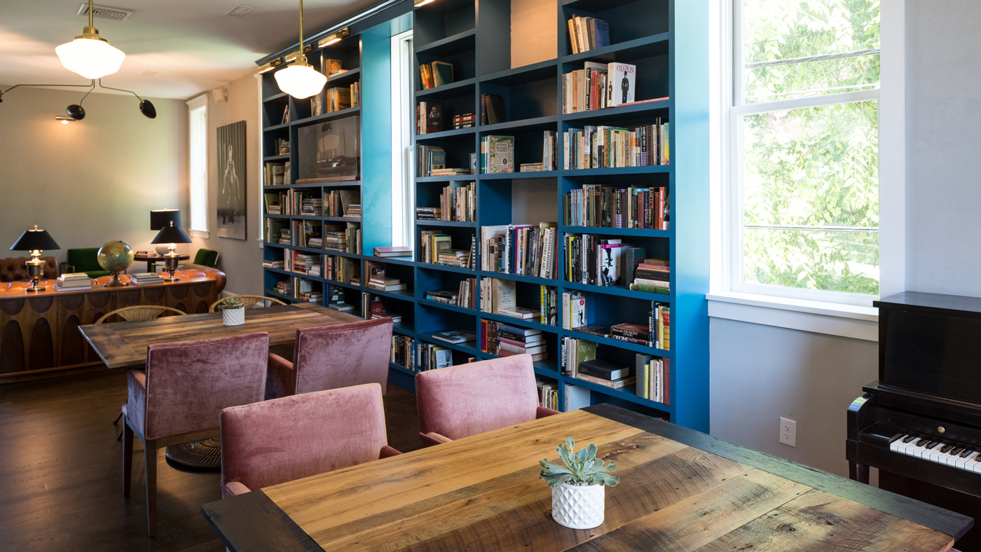 An image of books and seating space in the Library at Common House.