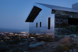 Phillip K. Smith's mirrored batons reflecting the light and landscapes around them.