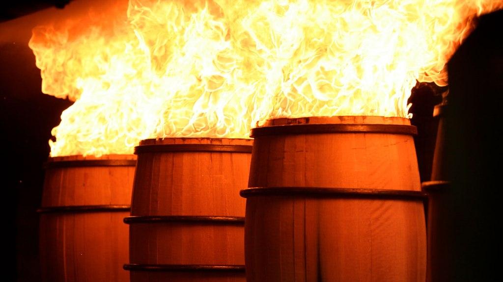Barrels being set on fire