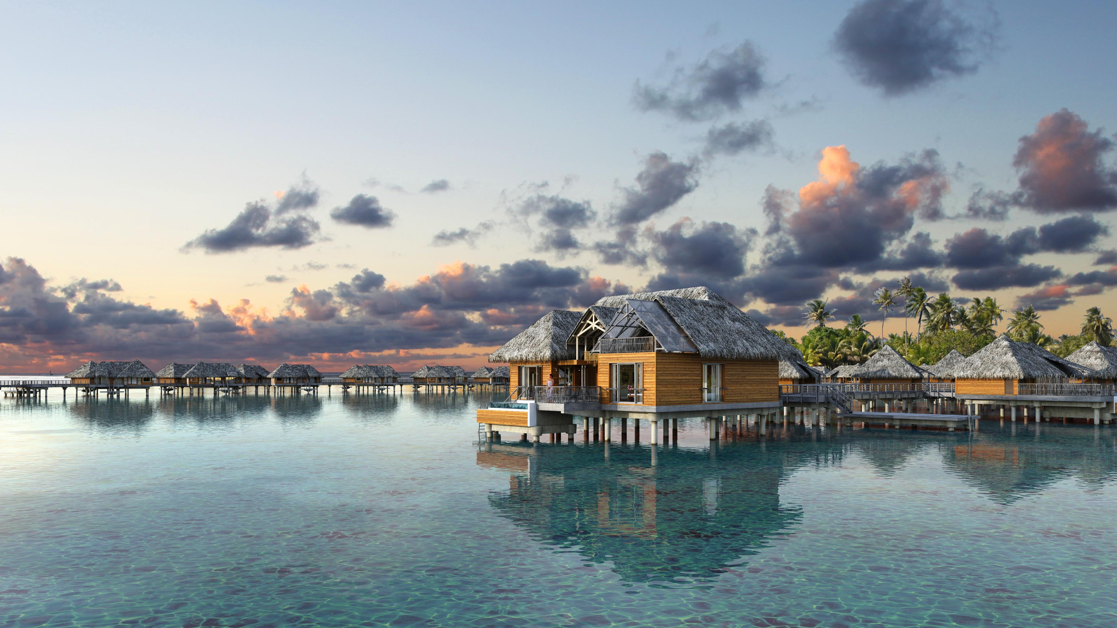 Brando Suites Bora Bora exterior at sunset of bungalow