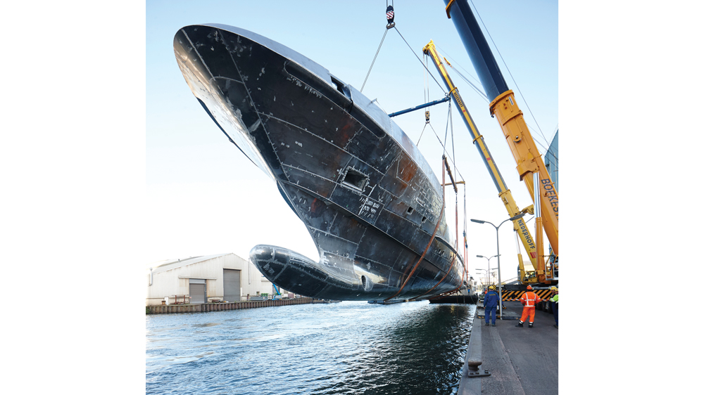 Galactica Super Nova yacht hull being dropped into the canal