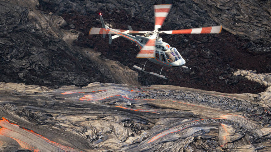 Helicopter over lava field