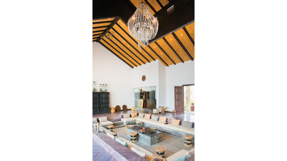 Meghauli Serai in Nepal and the interior of lodge with chandelier and open lounge