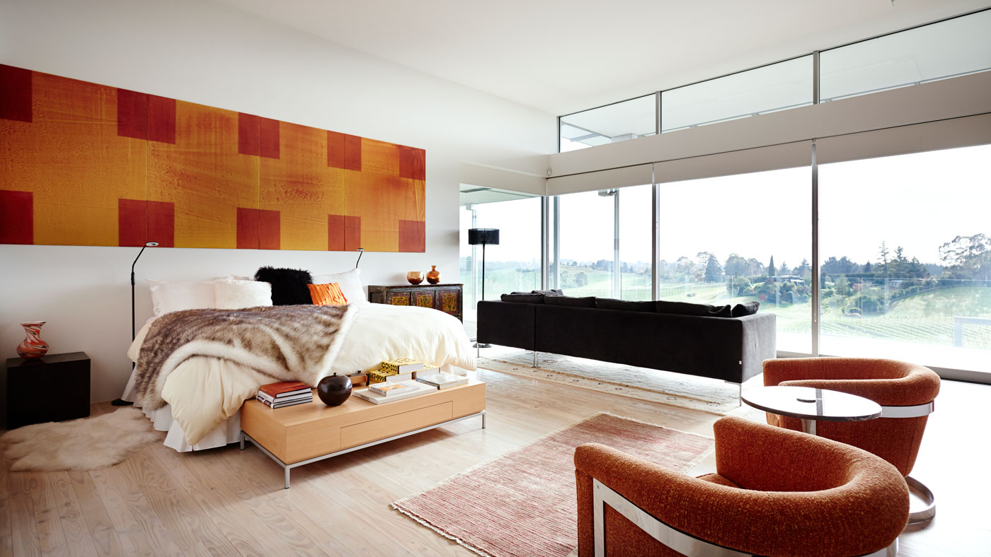 Art filled penthouse suite with floor to ceiling windows