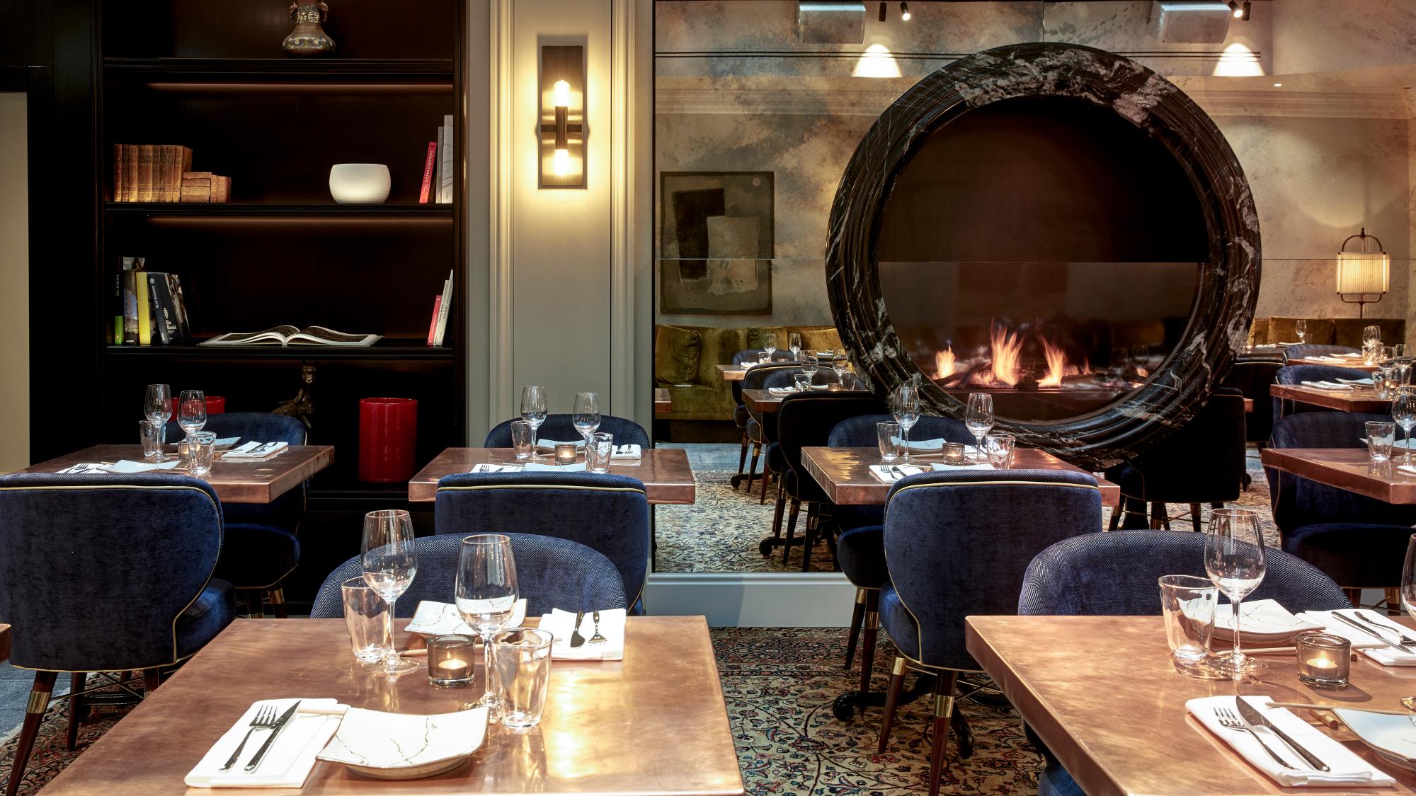 Sir Nikolai IZAKAYA Asian Kitchen and Bar Interior featuring large open fireplace