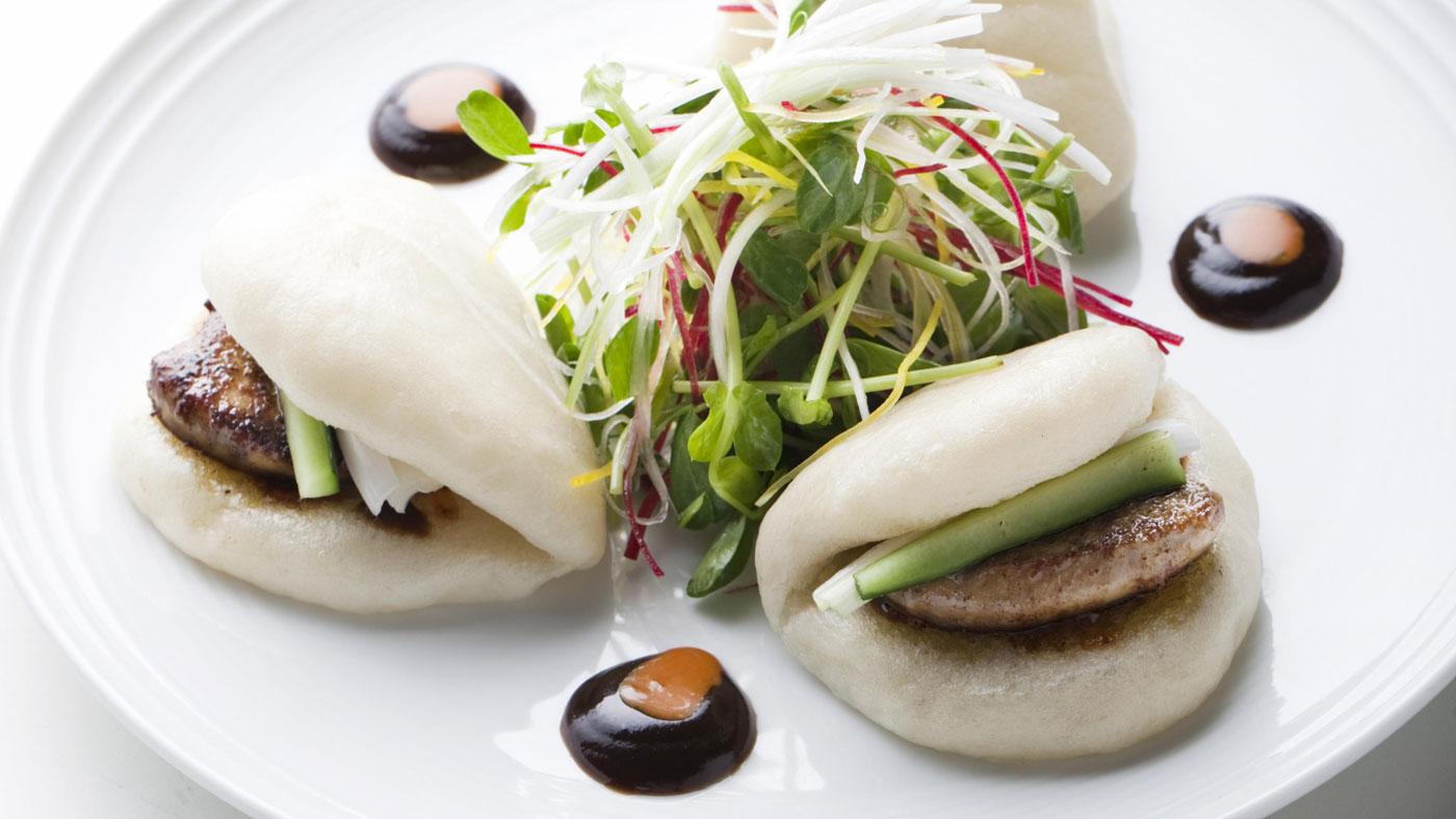 Bao Buns with slow-roasted pork on a white plate