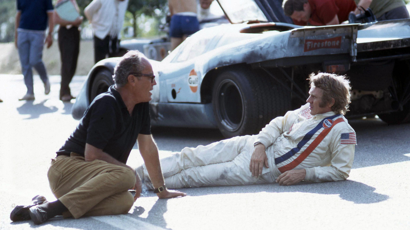 An image of one of the three Porsche 917Ks used during the making of Le Mans. John Sturges and Steve McQueen are in the foreground.