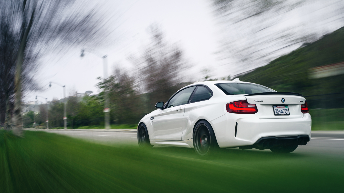 A photo of the Dinan BMW S2 M2 in motion.