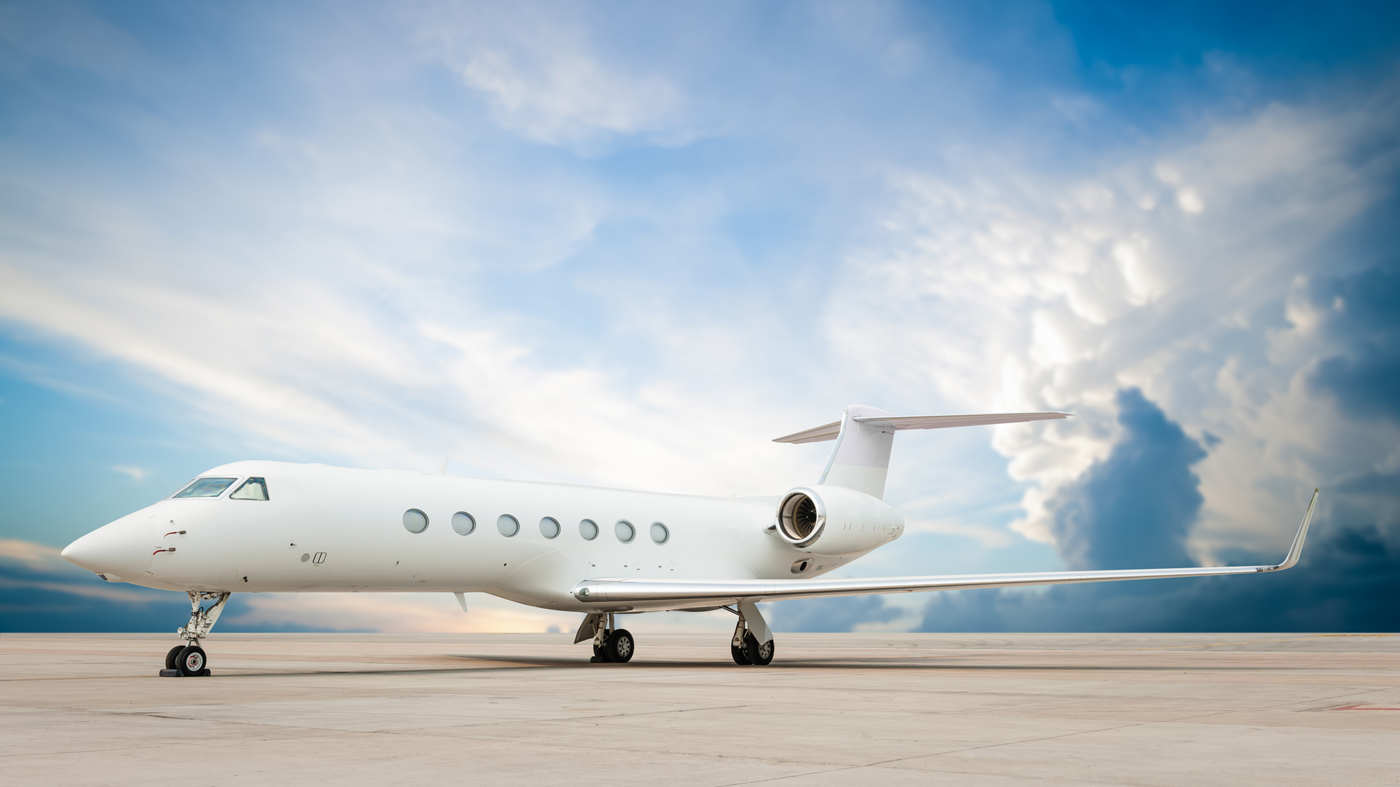 An image of a private jet on the tarmac.