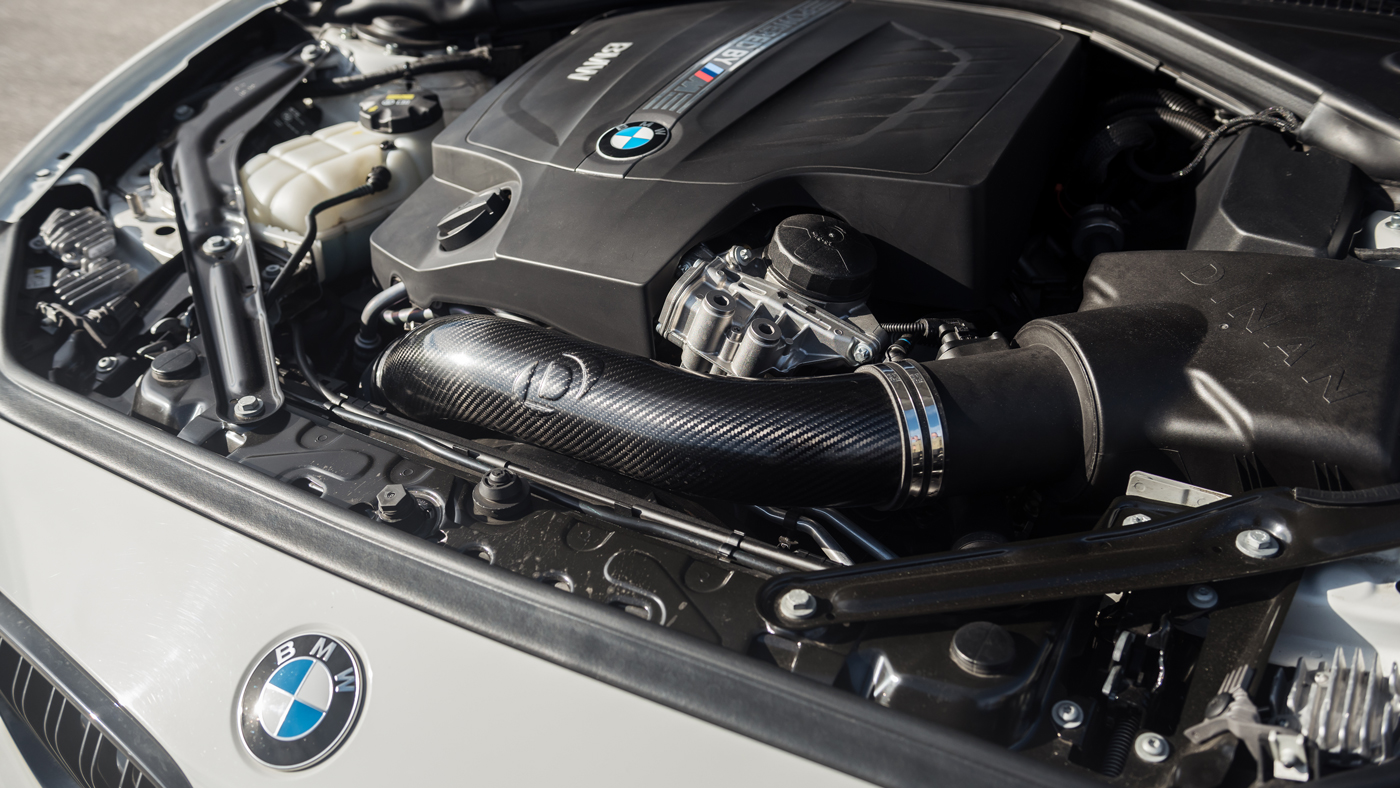 A photo of the Dinan BMW S2 M2's bolstered 3-liter inline-6 engine.