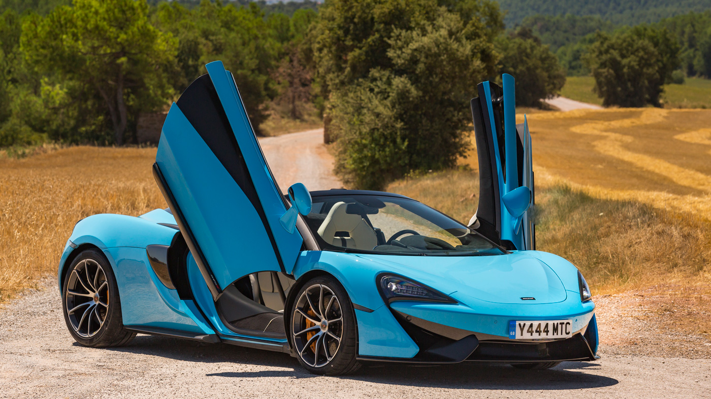 An image of the McLaren 570S Spider's dihedral doors on full display.