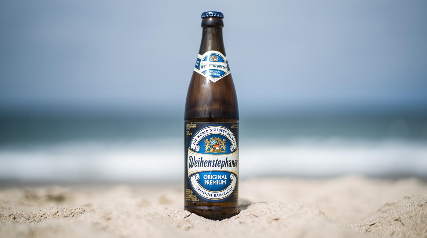 Photo of the Weihenstephaner Original Premium German helles lager at the beach