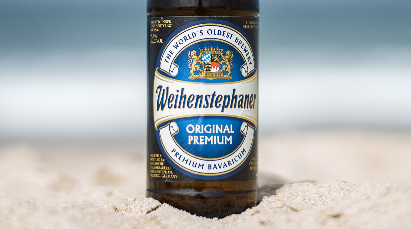 Photo of the label of the Label of the Weihenstephaner Original Premium German helles lager at the beach