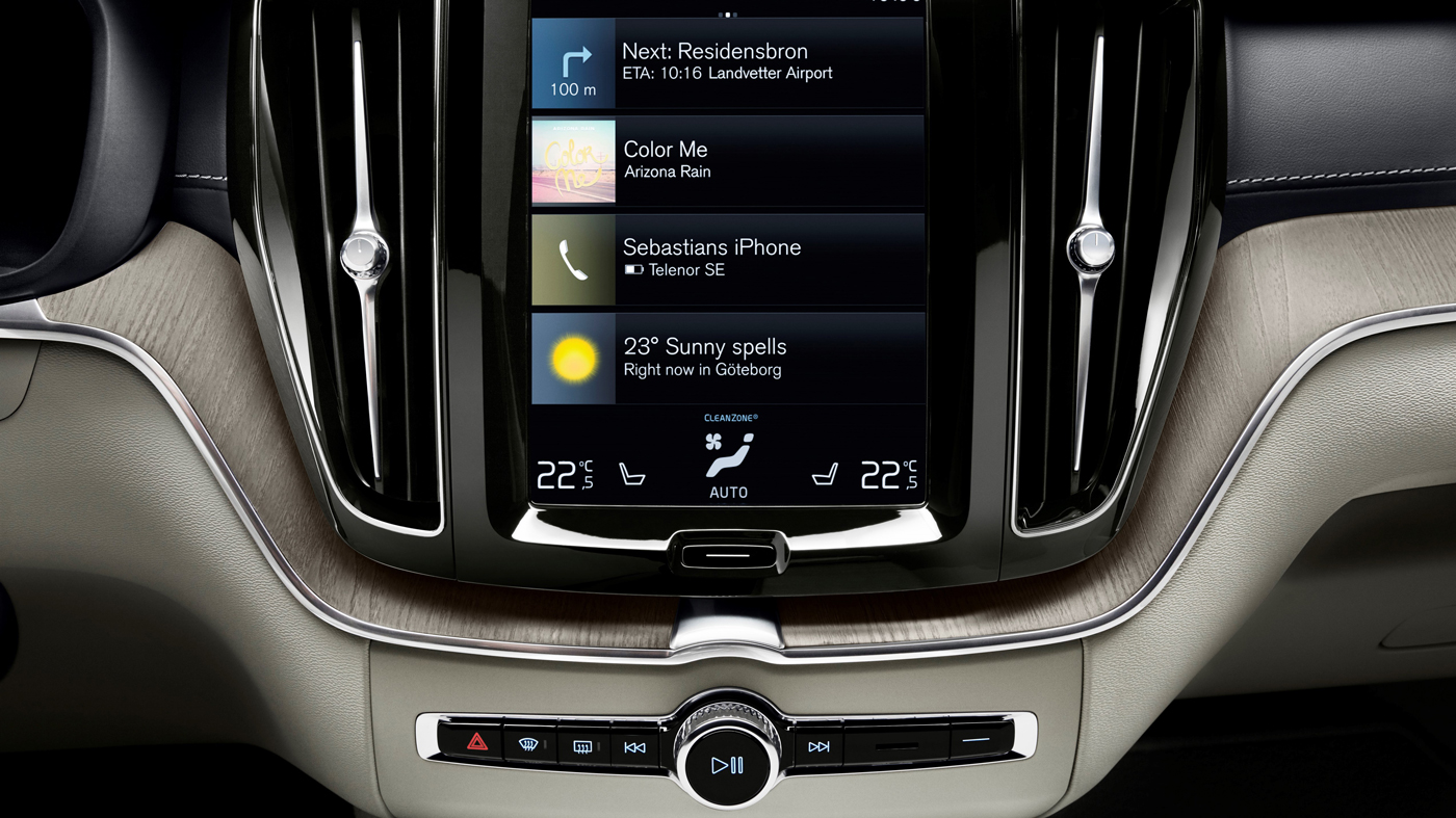 A photo of the Volvo XC60 T6 Inscription's 9-inch touchscreen with navigation and Volvo's Sensus interface.