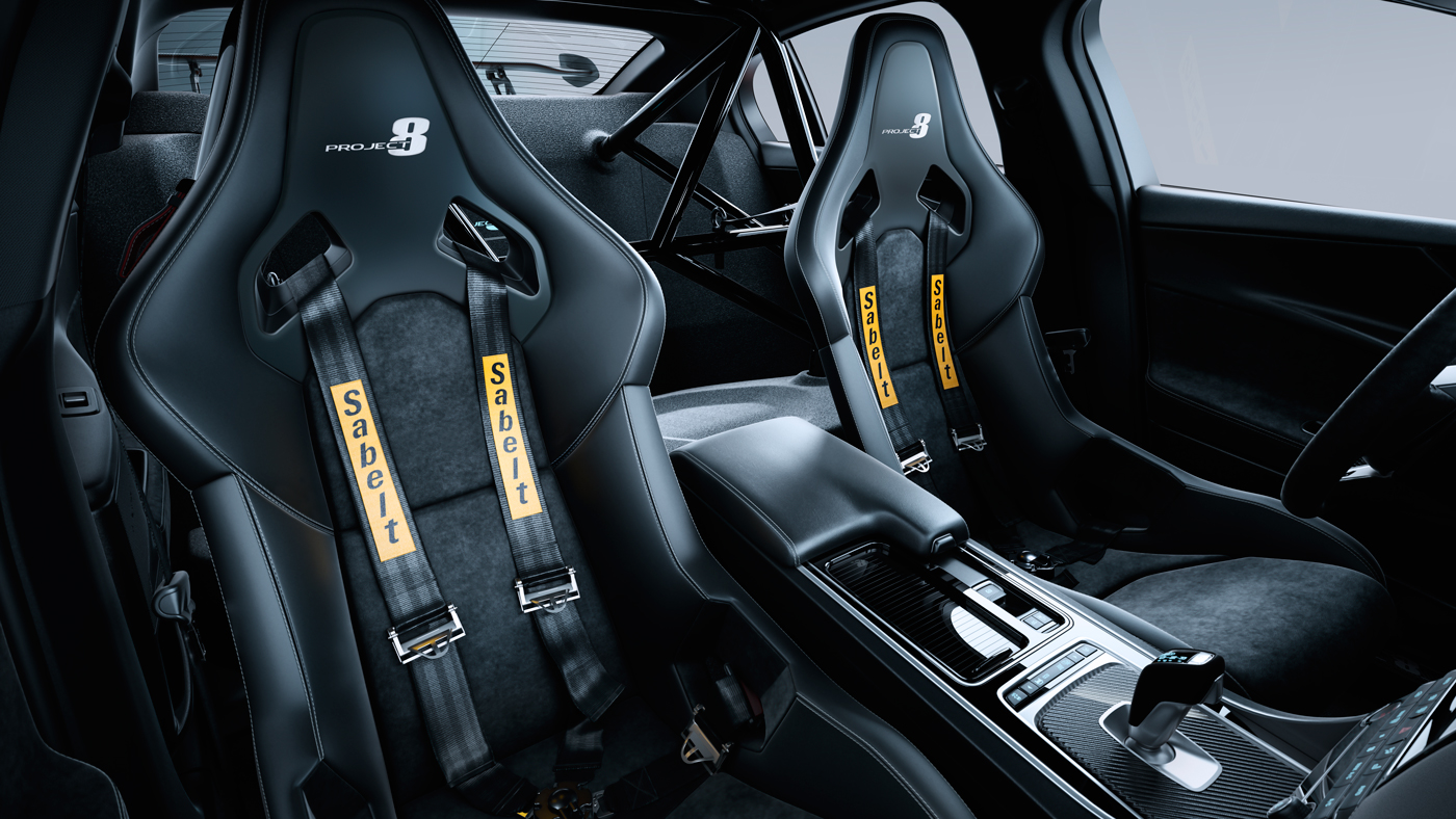 An image of the Jaguar XE SV Project 8's optional carbon-fiber seats sporting a four-point harness system.