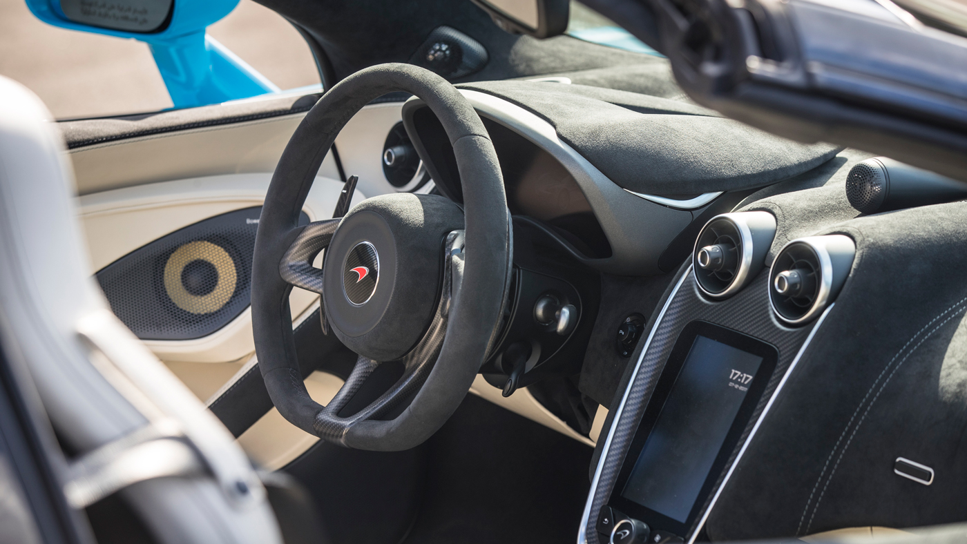 An image of the McLaren 570S Spider's electro-hydraulic power steering and 7-inch Iris touchscreen.