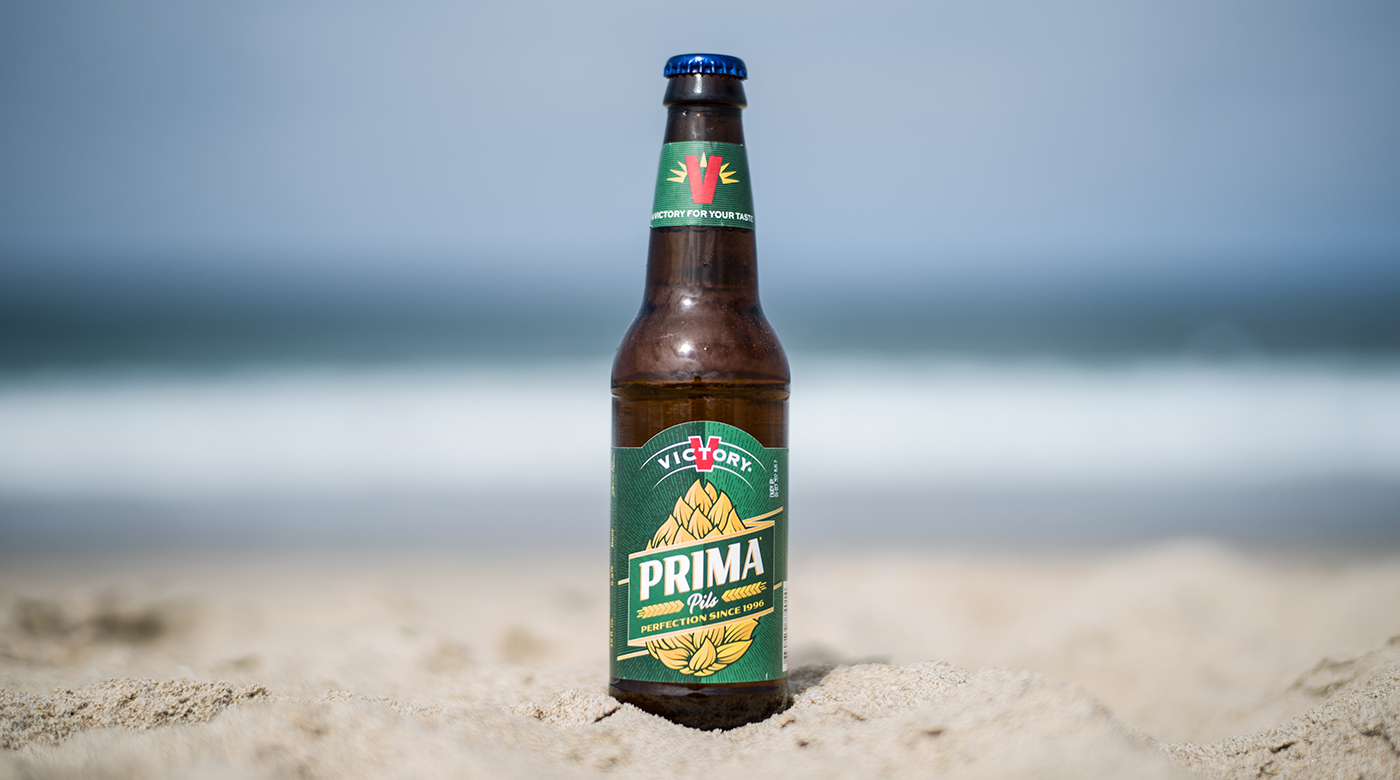 Photo of the Victory Brewing Company Prima Pils at the beach