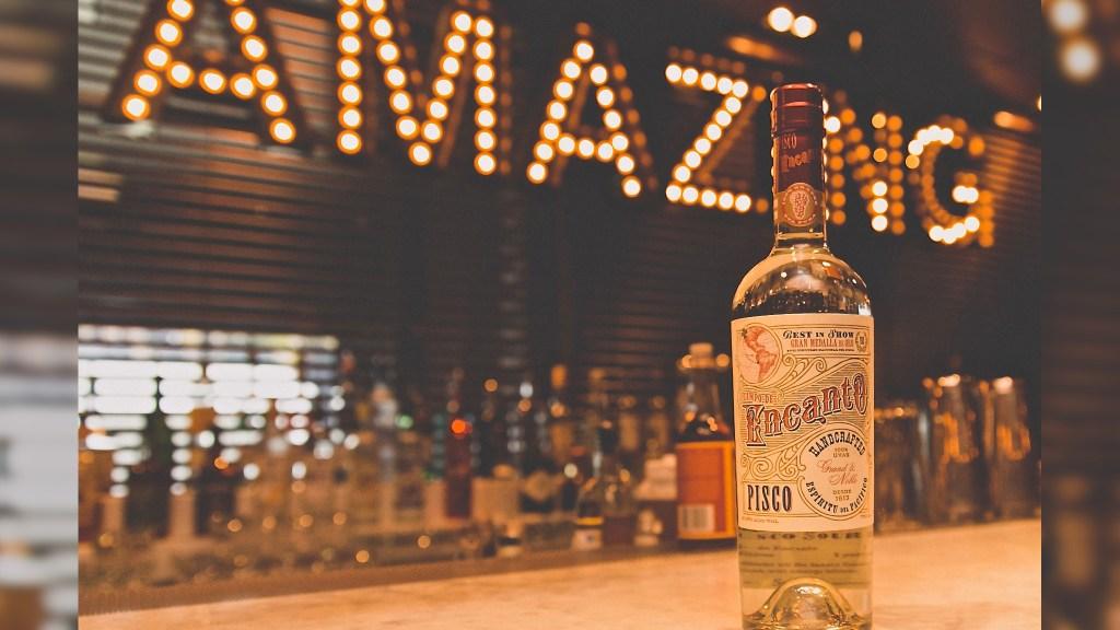 Campo de Encanto Grand & Noble spirits bottle on bar