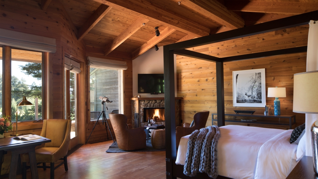 Rustic room with wood walls, as well as white and gray furnishing
