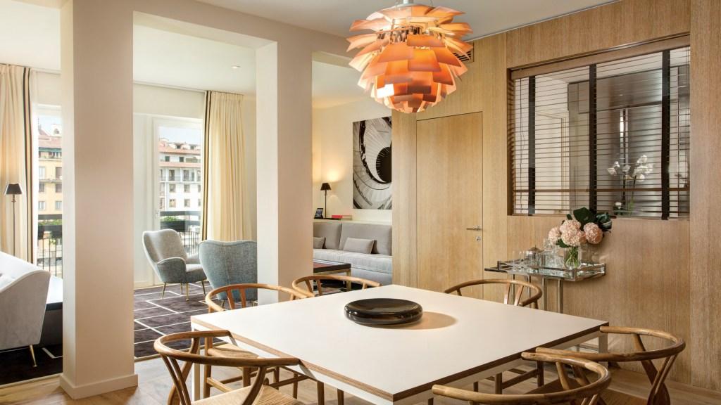 White table with orange light fixture