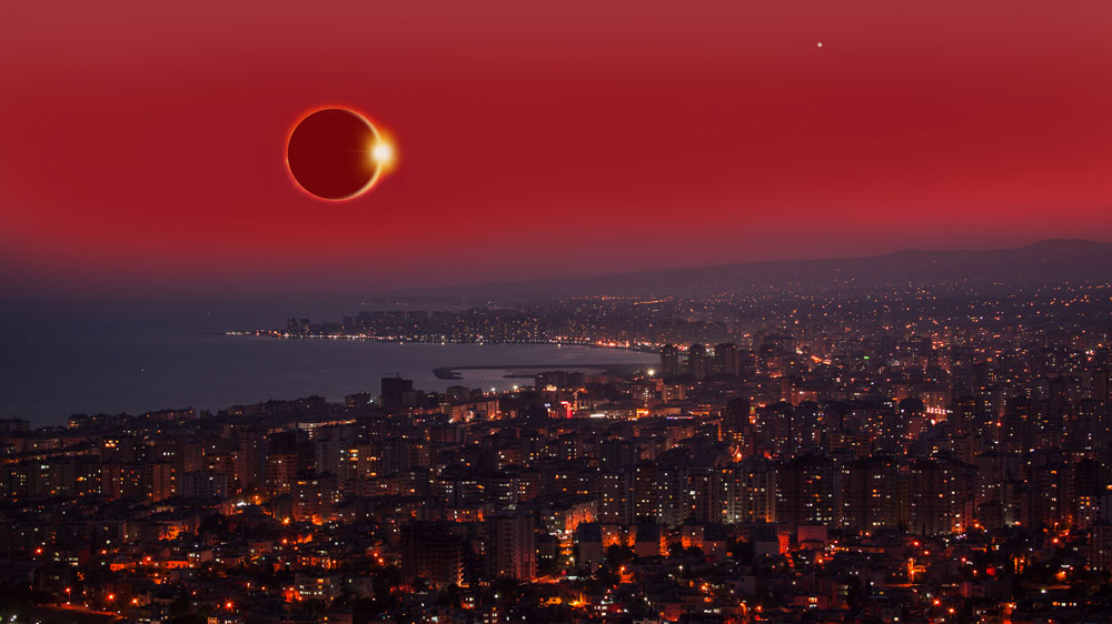 Solar eclipse over city