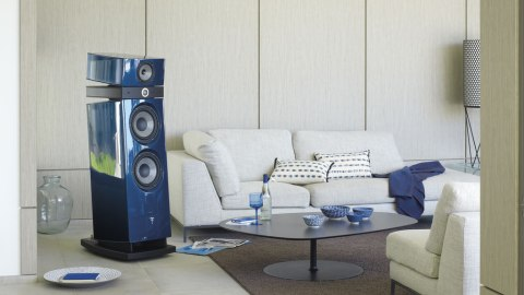 blue Focal Utopia Evo Maestro in living room next to couch