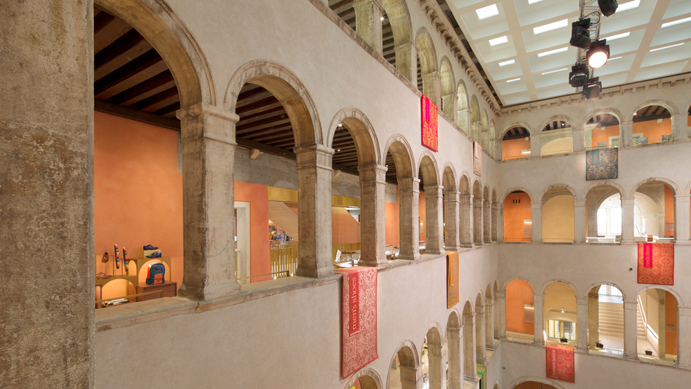 Fondaco dei Tedeschi interior with archways and stone walls