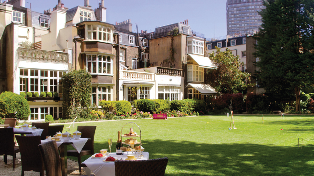 patio of the Goring Hotel in London looking at the green lawn