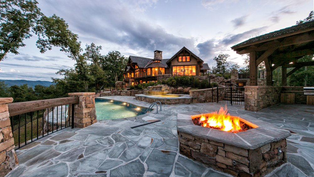greenbrier sporting club home with view of hot tub and fireplace outside