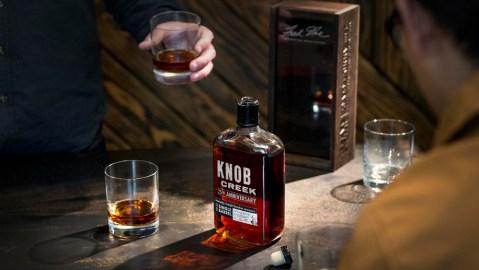 Knob Creek Bourbon bottle and men drinking