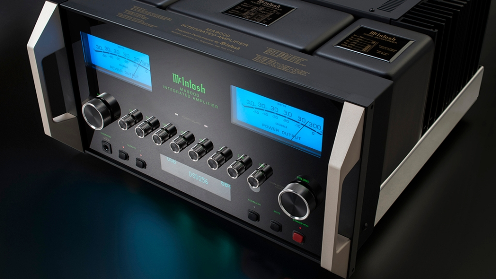 front view of McIntosh MA9000 integrated amp with glowing watt gauges