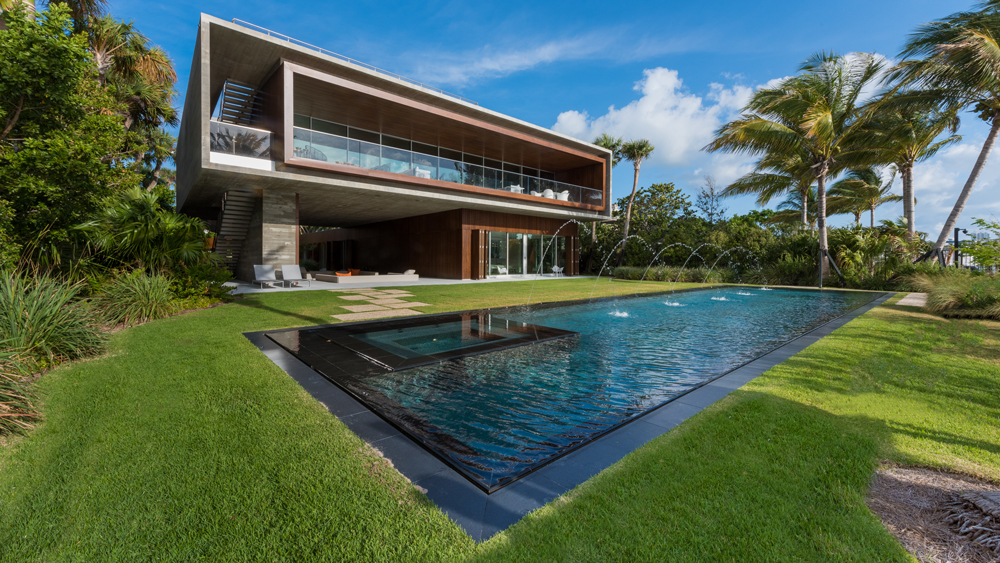Miami Jungle home with lagoon pool view