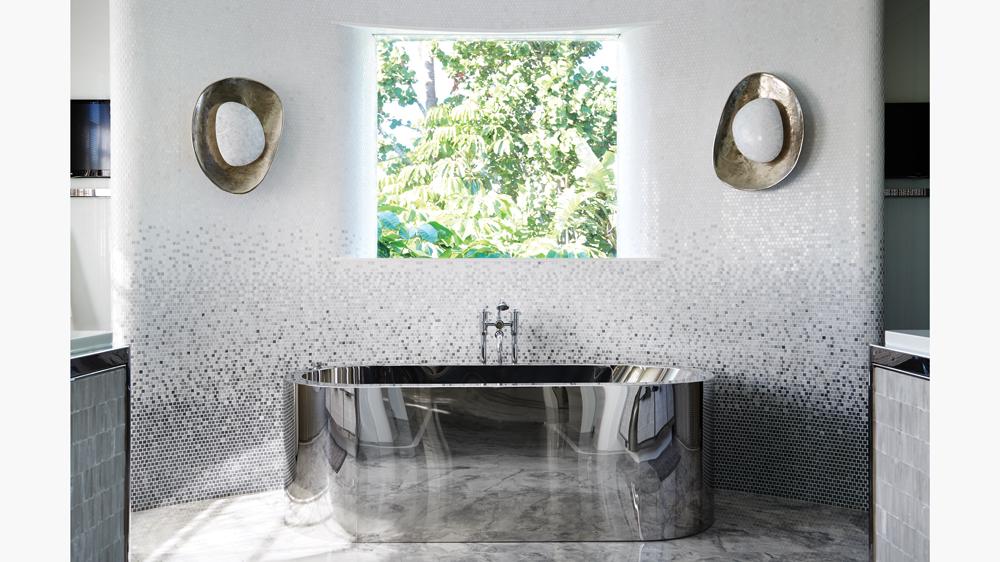 art deco palm beach home bathroom with marble mosaic