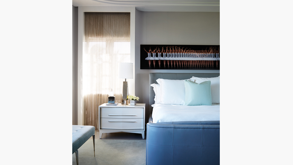 palm beach art deco bedroom featuring designer lamps and lambswool-upholstered furnishings