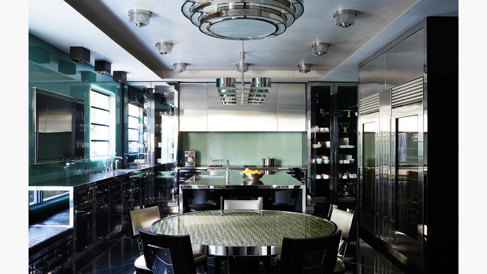 interior of palm beach art deco home featuring steel kitchen appliances