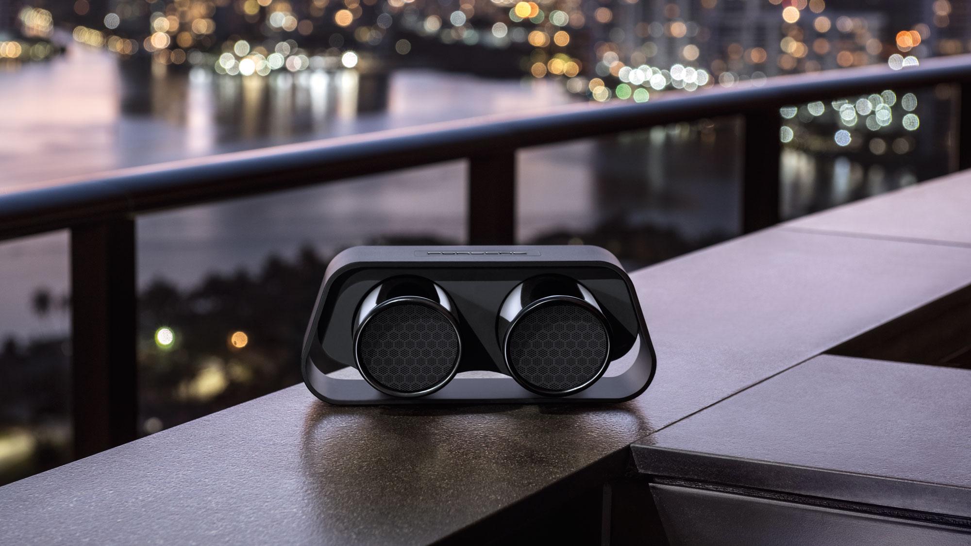 Porsche Design 911 Speaker against nighttime cityscape