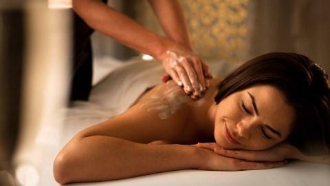 woman getting a back massage at the Ritz Carlton Spa Massage