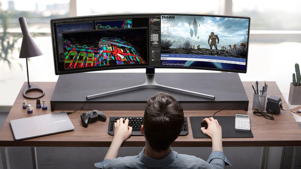 Man Playing on Samsung 49-Inch CHG90 QLED Gaming Monitor on desktop