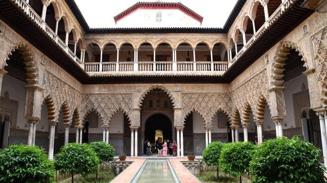 historic Moorish-style building with green bushes