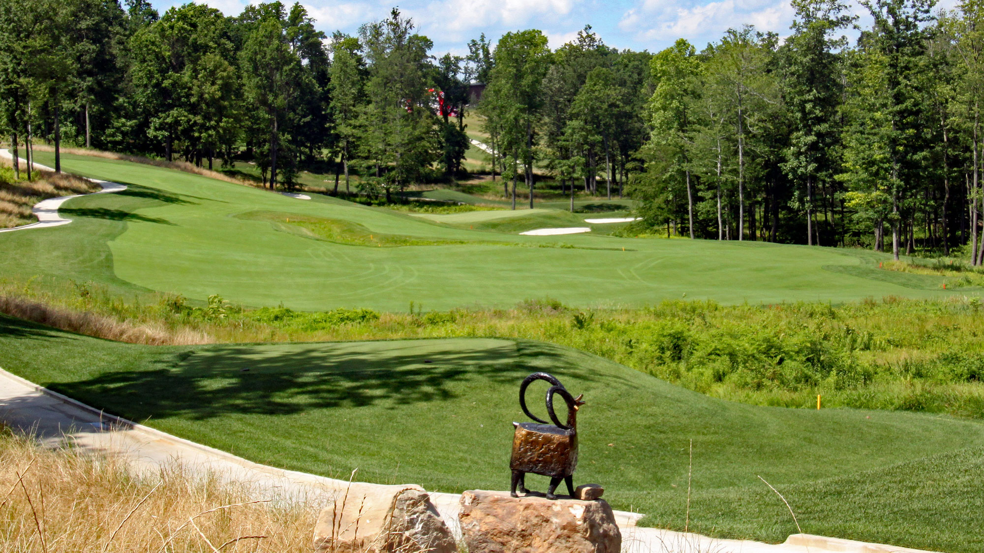 Pete Dye's Shepherd's Rock hole 10 with sheep statue in front