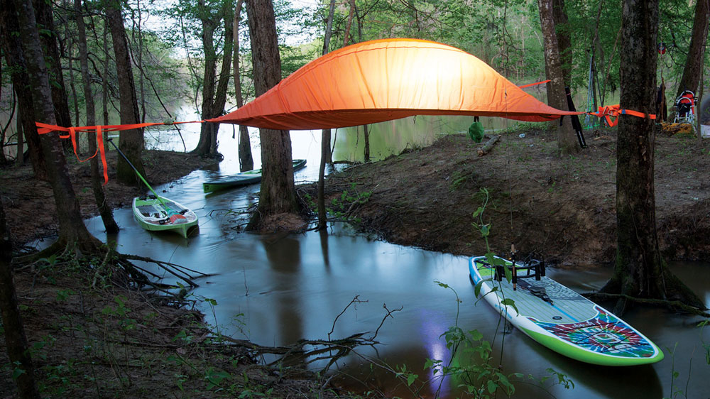 illuminated Tentsile Stingray suspended above a creek