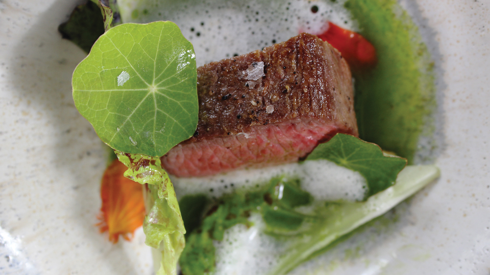 Wolfgang Puck's Rogue Experience image of steak