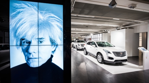 """An image of Andy Warhol and a line of Cadillacs are part of the """"Letters to Andy Warhol"""" exhibition in Munich."""