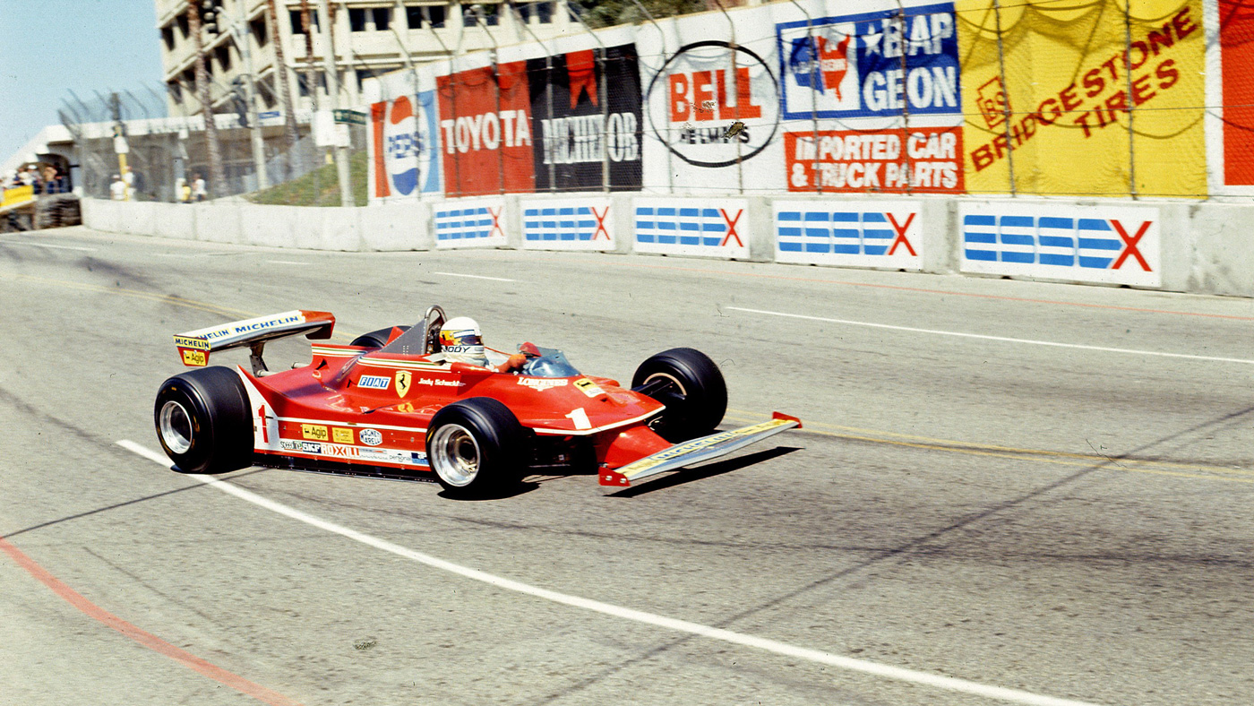 Jody Scheckter and his 1980 Ferrari 312 T5 Single-Seater Formula 1 racer in action.