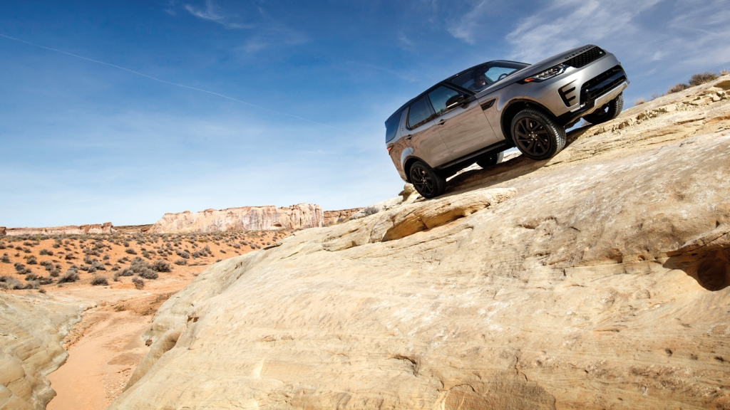 A Land Rover Discovery deliberately gets a bit sideways in Moab, Utah.