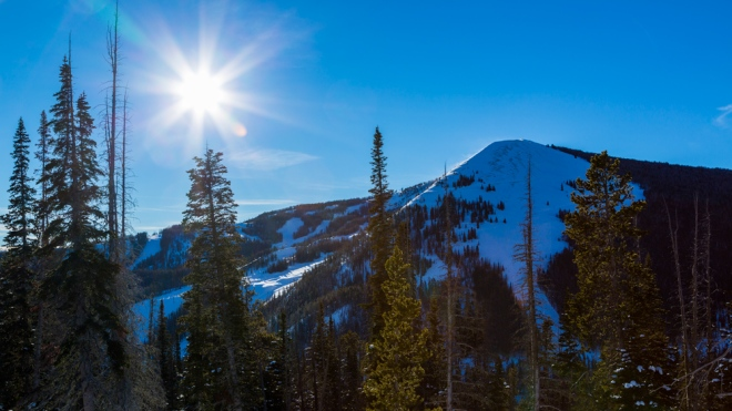 sunny clear sky over snowy mountains at Cedar View Ranch at Yellowstone Club
