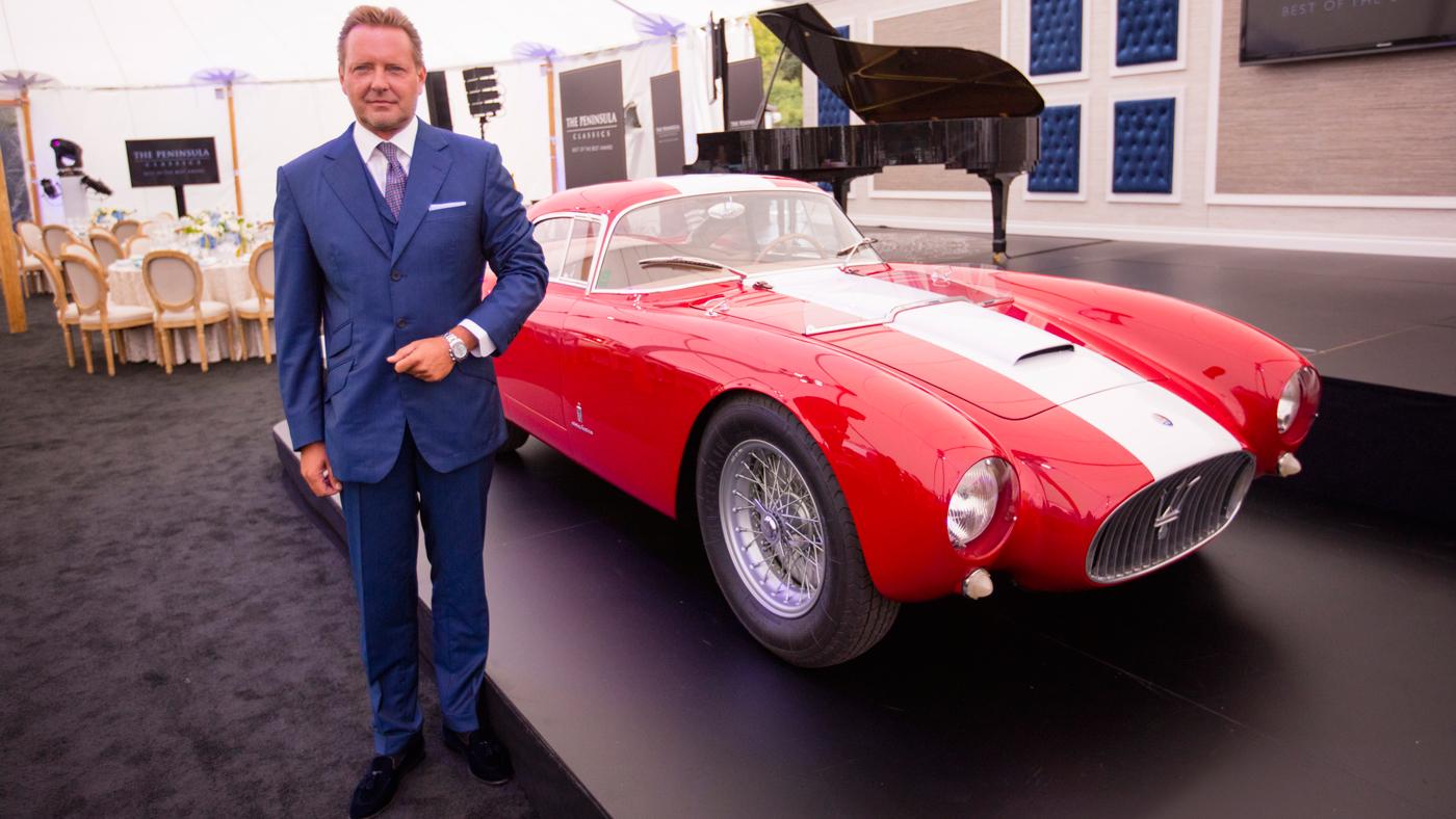 Timm Bergold stands next to his 1954 Maserati A6GCS/53 Berlinetta., winner of the Peninsula Classics Best of the Best Award.