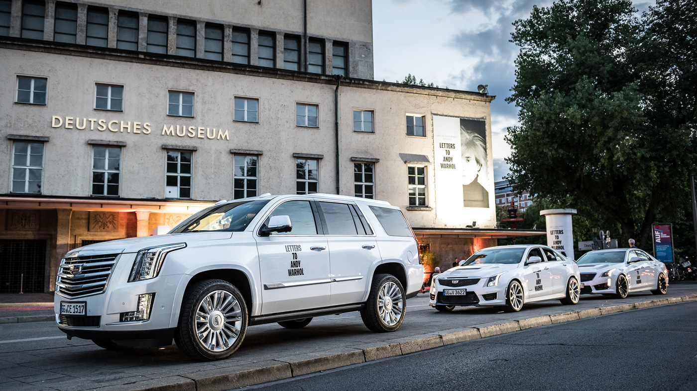 """A cadre of Cadillacs line up in front of the """"Letters to Andy Warhol"""" exhibition in Munich."""